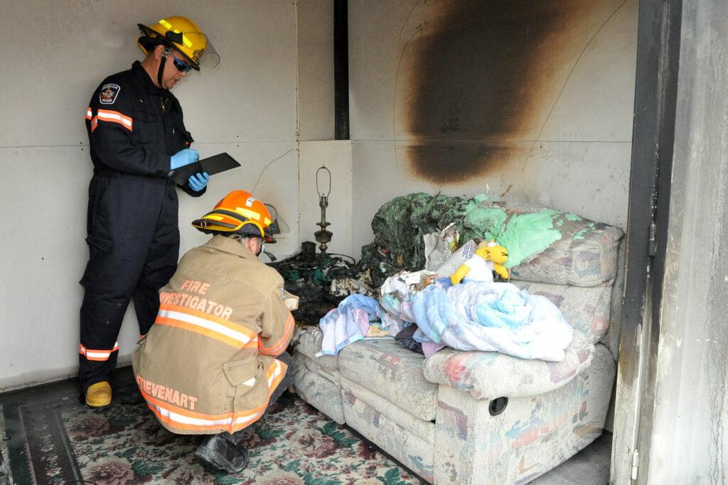 Festi Firefighters Inspecting House Fire